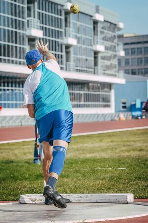 old man shot put during the athletics competitions