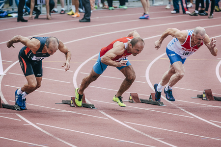 Chelyabinsk, Russia - August 28, 2015:  old men start at 100 meters during championship of Russia on track and field athletics among the elderly, Chelyabinsk, Russia - August 28, 2015
