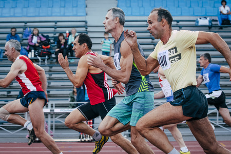 Chelyabinsk, Russia - August 28, 2015:  competition old men athletes at the distance of 100 meters during championship of Russia on track and field athletics among the elderly, Chelyabinsk, Russia - August 28, 2015