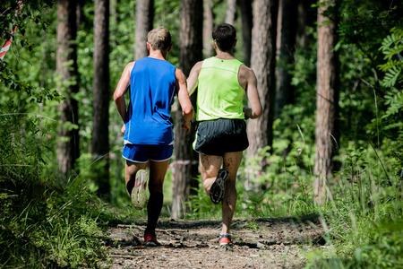 detai: two men running through the woods