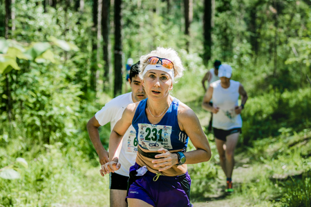 28: Miass, Russia - June 28, 2015: Unidentified old woman run during marathon Running clean water-2015, Miass, Russia - June 28, 2015