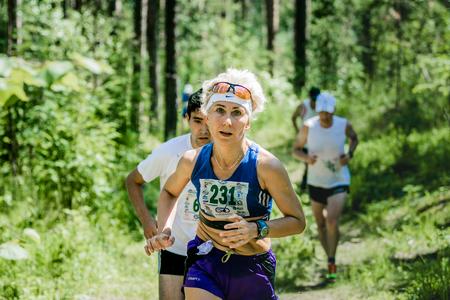 hyperhidrosis: Miass, Russia - June 28, 2015: Unidentified old woman run during marathon Running clean water-2015, Miass, Russia - June 28, 2015