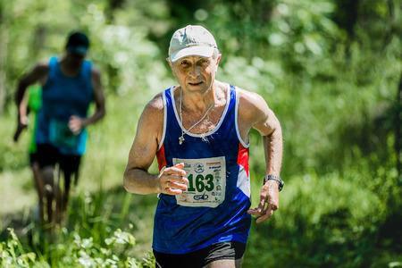 Miass, Russia - June 28, 2015: old man run during marathon Running clean water-2015, Miass, Russia - June 28, 2015 Editorial