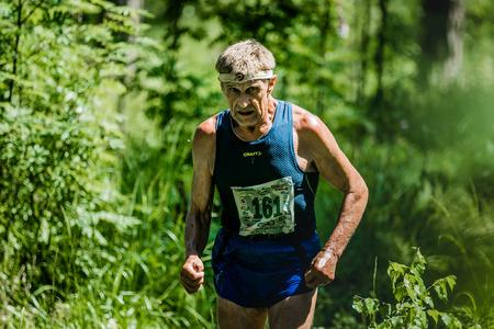 hyperhidrosis: Miass, Russia - June 28, 2015: Unidentified old man run during marathon Running clean water-2015, Miass, Russia - June 28, 2015