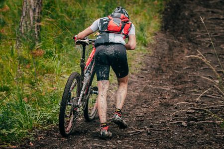 uphill: Miass, Russia - July 19, 2015: mountainbiker in a uphill race during race Clean water-2015, Miass, Russia - July 19, 2015 Editorial