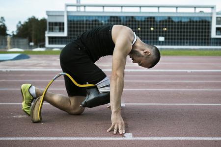 The handicap athlete preparing to start running