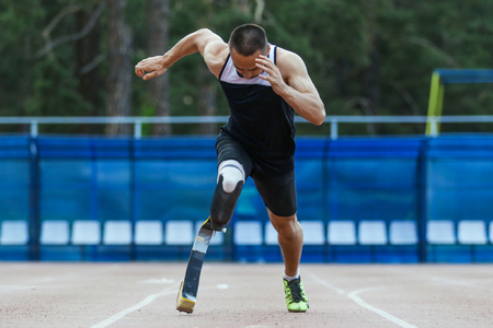 Explosive start of athlete with handicap at the stadium