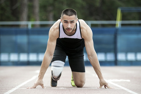 The disabled athlete preparing to start running Standard-Bild