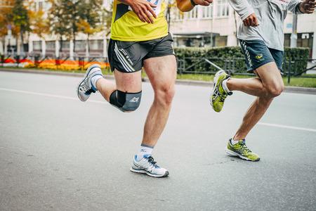 kneecap: Chelyabinsk, Russia - September 6, 2015: two athletes running on asphalt during Chelyabinsk marathon, Chelyabinsk, Russia - September 6, 2015 Editorial