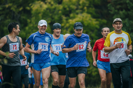 comrades: Chelyabinsk, Russia - September 6, 2015: group of middle-aged joggers running in the Park during Chelyabinsk marathon, Chelyabinsk, Russia - September 6, 2015 Editorial