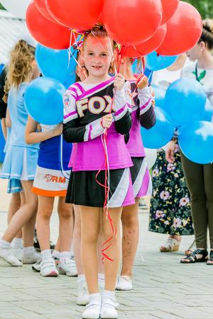 june 25: Chelyabisk, Russia - June 25, 2015: girl cheerleading during Championship in rowing, kayaking and Canoeing, Chelyabisk, Russia - June 25, 2015 Editorial