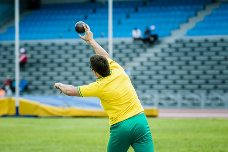 put on: shot put men at competitions Stock Photo