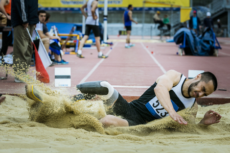 disability: Amputee athlete long jump during The universities championship of Chelyabinsk region in athletics