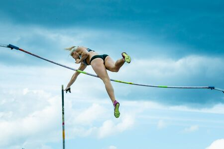 Chelyabinsk, Russia - June 10, 2015: A female athlete competing in the pole vault during The universities championship of Chelyabinsk region in athletics