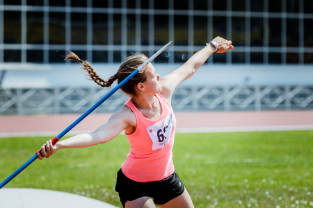 javelin throw: Chelyabinsk, Russia - June 16, 2015: A girl athlete competing in the javelin throw during Championship of Chelyabinsk region in athletics Editorial