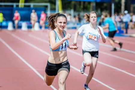 rival rivals rivalry season: Chelyabinsk, Russia - June 16, 2015: A girl athlete runs 400 m during Championship of Chelyabinsk region in athletics Editorial