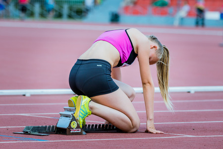 Chelyabinsk, Russia - June 16, 2015:Girl athlete in starting position 400 m during Championship of Chelyabinsk region in athletics