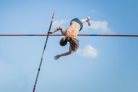 vaulting: Chelyabinsk, Russia - July 24, 2015:  Girl athletes pole vault during National competitions in memory of G. I. Nicewhen athletics, Chelyabinsk, Russia - July 24, 2015