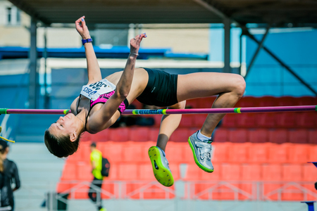 Chelyabinsk, Russia - July 24, 2015: girl athlete high jump during National competitions in memory of G. I. Nicewhen athletics, Chelyabinsk, Russia - July 24, 2015