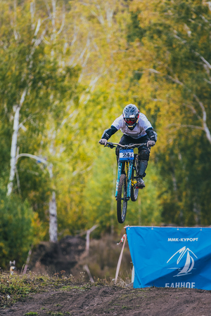 magnitogorsk: Magnitogorsk, Russia -  September 12, 2015: jump ski racer on the mountain bike during Urals Cup of downhill bike, Magnitogorsk, Russia -  September 12