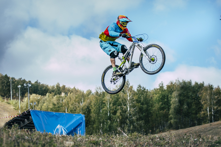 springboard: Magnitogorsk, Russia -  September 12, 2015: Athlete on a mountain bike is flying in a jump from a springboard during Urals Cup of downhill bike, Magnitogorsk, Russia -  September 12 Editorial