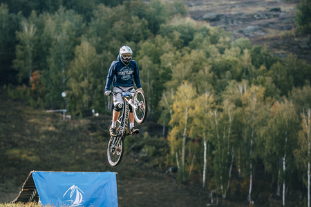 magnitogorsk: Magnitogorsk, Russia -  September 12, 2015: flight of the rider on the bike during Urals Cup of downhill bike, Magnitogorsk, Russia -  September 12 Editorial