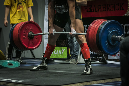 Chelyabinsk, Russia - July 17, 2015:  athlete performs a deadlift during National championship powerlifting, bench press and deadlift, Chelyabinsk, Russia - July 17, 2015