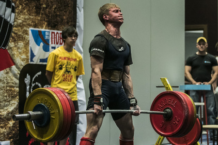 Chelyabinsk, Russia - July 17, 2015:  athlete of powerlifter performs a deadlift  during National championship powerlifting, bench press and deadlift, Chelyabinsk, Russia - July 17, 2015