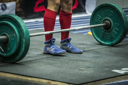 powerlifting: Chelyabinsk, Russia - July 17, 2015:  athlete getting ready for a deadlift during National championship powerlifting, bench press and deadlift, Chelyabinsk, Russia - July 17, 2015