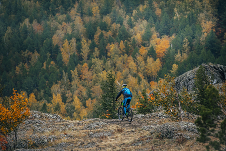 magnitogorsk: young man on mountain bike in the mountains travel