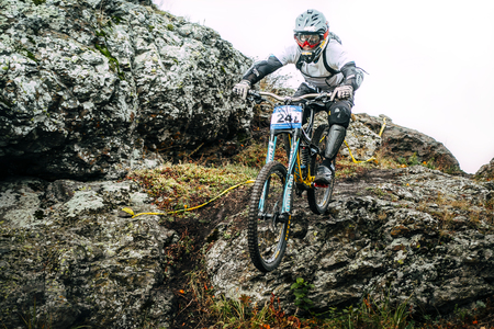 magnitogorsk: Magnitogorsk, Russia -  September 12, 2015: athlete at the mountain bike down the cliff during Urals Cup of downhill bike, Magnitogorsk, Russia -  September 12 Editorial