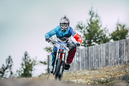 Magnitogorsk, Russia -  September 12, 2015: downhill racer bike during Urals Cup of downhill bike, Magnitogorsk, Russia -  September 12 Editorial