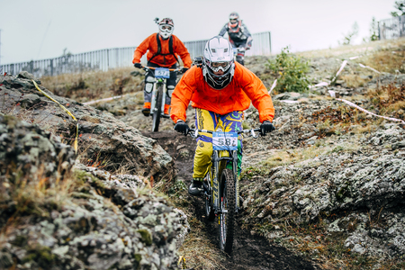 magnitogorsk: Magnitogorsk, Russia -  September 12, 2015:training run three riders mountain bikers during Urals Cup of downhill bike, Magnitogorsk, Russia -  September 12 Editorial