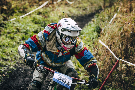 magnitogorsk: Magnitogorsk, Russia -  September 12, 2015: racer cyclist goes the distance during Urals Cup of downhill bike, Magnitogorsk, Russia -  September 12