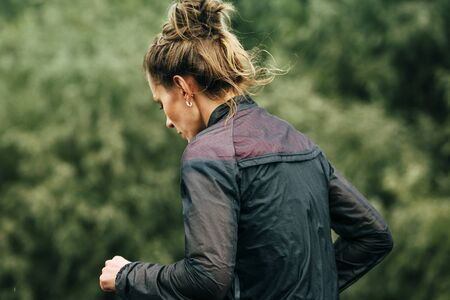 participant: Omsk, Russia -  September 20, 2015: girl runner participant of marathon during Siberian international marathon