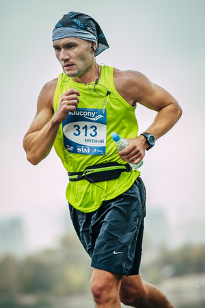 rivals rival rivalry season: Omsk, Russia -  September 20, 2015: young athlete closeup against sky during Siberian international marathon Editorial