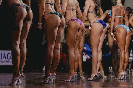 girls bottom: Side view of beautiful girls in bikini bottom to compete in a fitness bikini