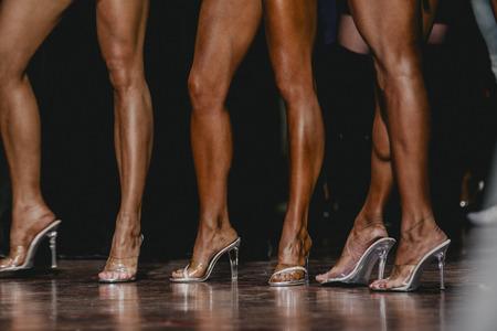 compete: slender beautiful woman legs in high heels. women to compete in fitness bikini