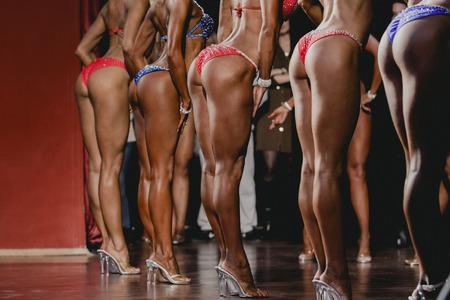 side view girls fitness bikini. beautiful in slim swimsuit bikini