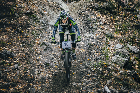 mountain bicycling: Sludorudnik, Russia - September 13, 2015: top view racer biker riding through woods during Blagikh Racing Cup mountain bike Editorial