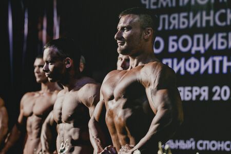 straining: Chelyabinsk, Russia - October 3, 2015: athletes bodybuilders are straining your chest and press during Championship of Chelyabinsk region on bodybuilding, bodyfitness and fitness Editorial