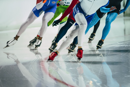Chelyabinsk, Russia - October 15, 2015: group of female speed skaters warm up before starting during Cup of Russia on speed skating Editorial