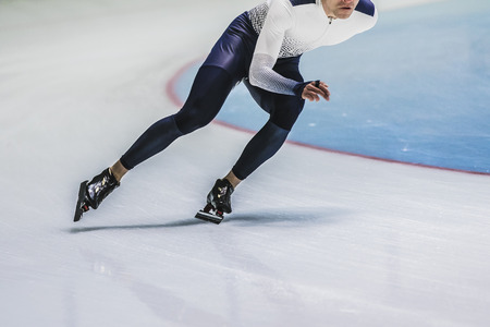skaters: man speed skaters riding on ice