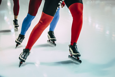 skaters: closeup of girls legs of speed skaters
