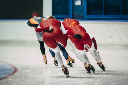 skaters: girl speed skaters in warm-up before start of competition Stock Photo