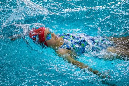 backstroke: Chelyabinsk, Russia - October 21, 2015: young girl swimming backstroke in pool during Championship of Chelyabinsk swimming Editorial