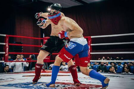 mixed martial arts: Volgograd, Russia - October 24, 2015: athlete mixed martial arts hits his hand on head of opponent during Championship of Russia on mixed martial arts