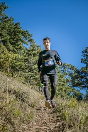 rival rivals rivalry season: Yalta, Russia - October 31, 2015: young male athlete runs from mountain during First Yalta mountain marathon Editorial