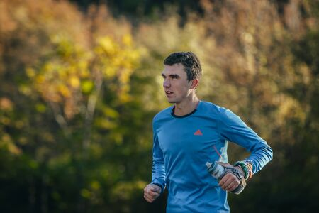 rival rivals rivalry season: Yalta, Russia - October 31, 2015: young young athlete running in autumn forest during First Yalta mountain marathon Editorial