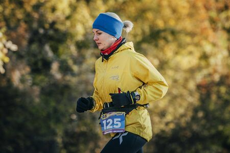 rival rivals rivalry season: Yalta, Russia - October 31, 2015: young woman runner running in autumn forest during First Yalta mountain marathon